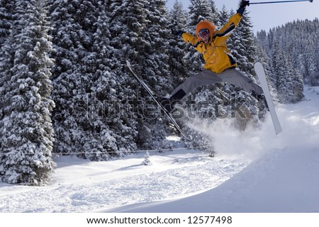 Snow Skier Jumping in winter forest in mountains (series sport, mountains, extreme, horses, teenagers)