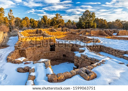Snow surrounds the remains of mesa top Coyote Village on Chapin Mesa in Mesa Verde National Park, Colorado. Stock photo ©