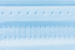 snow track imprint of snowmobile, close-up view