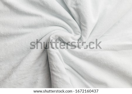 Snow-white velvet background or veluree flannel texture made of cotton or wool with soft fluffy velvet atlas cloth. Curly twisted fabric background. Foto stock ©