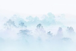 snow winter forest. silhouette forest covered in fog during winter morning. misty mountain. great outdoor location in Thailand.