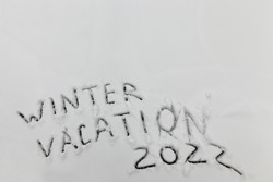 snow with drawings of words winter holidays in the winter season, words winter holidays drawn on snow