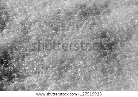 Snow with patterns of shadows and fresh ice crystals