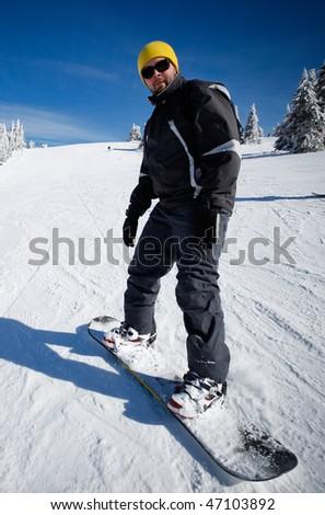 Snowboard beginner enjoys a snow slope ride