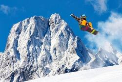 snowboard jump in alpine landscape