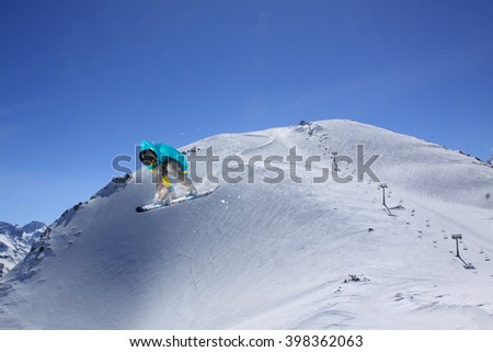 Snowboard jump on mountains. Extreme winter sport. #398362063