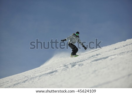 snowboard woman racing downhill slope and freeride on powder snow at winter season and sunny day