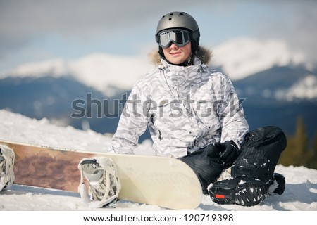 snowboarder against sun and sky - stock photo