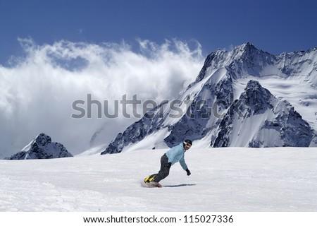 Snowboarder at ski resort in Caucasus Mountains