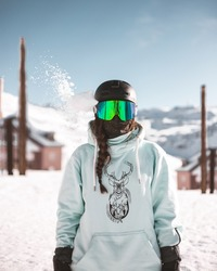 snowboarder girl in the mountain