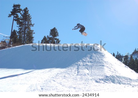 Snowboarder going off of a big jump. #2434914
