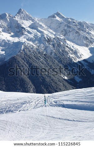 Snowboarder gooing to freeride trace in the mountain