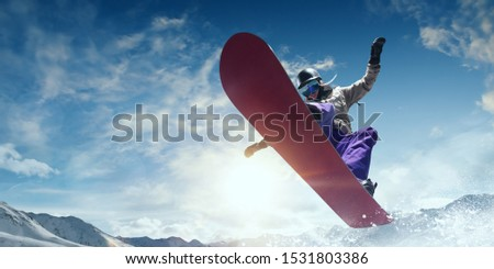 Snowboarder in action. Extreme winter sports. #1531803386
