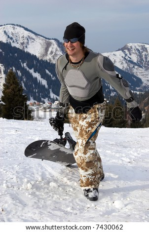 Snowboarder in defence on ski resort slope