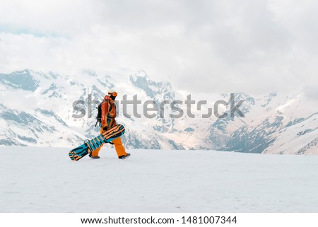 snowboarder in the Caucasus mountains in winter, snow ,Russia