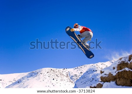 snowboarder is jumping with rocket grab