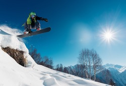snowboarder is jumping with snowboard from snowhill