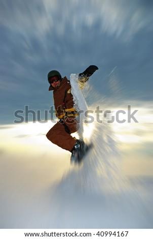 Snowboarder jump in powder