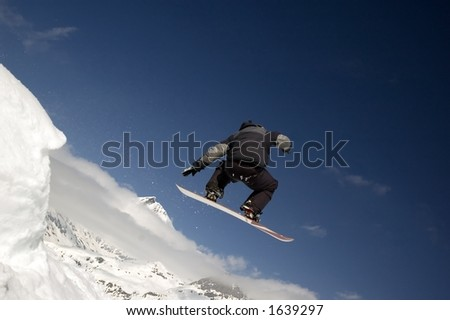 snowboarder jumping high in the air #1639297