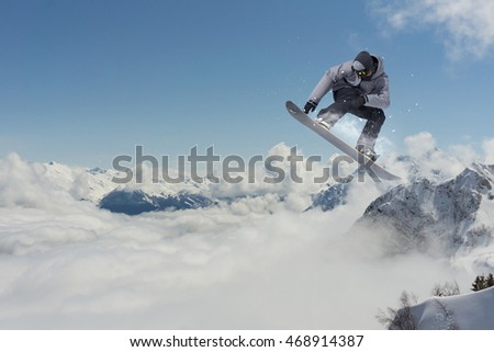 Snowboarder jumping in mountains, extreme sport. #468914387