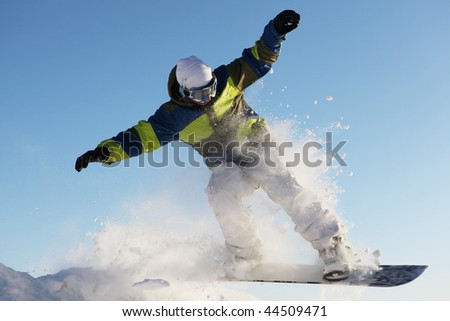 snowboarder jumps  against the sky