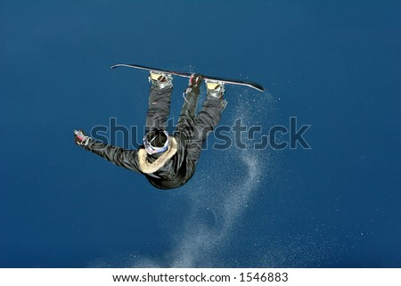 Snowboarder jumps and do some atractive tric. Imagine de stoc ©