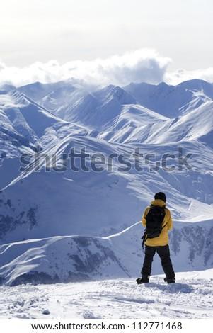 Snowboarder on top of mountain. Caucasus Mountains, Georgia, ski resort Gudauri.