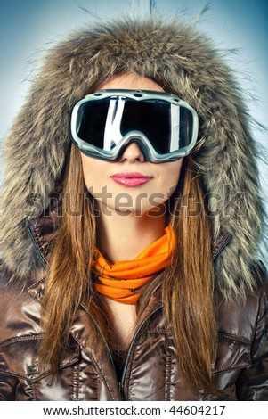 Snowboarder woman wearing a hood and mask - stock photo