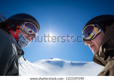 snowboarders and skiers - stock photo