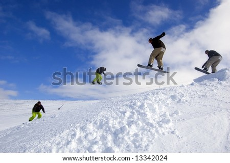 Snowboarders jumping - cool extreme sports action at Cairngorm Mountain in Scotland