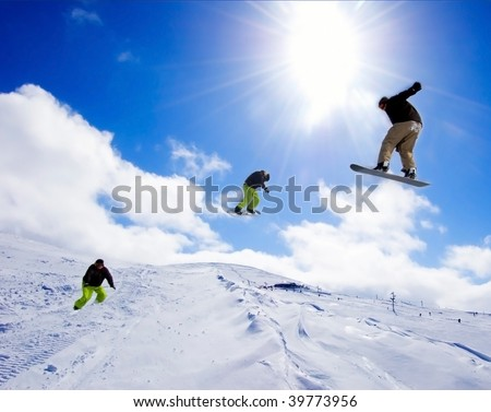 Snowboarders mid air
