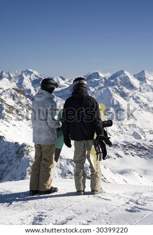 Snowboarders on the peak of mountain