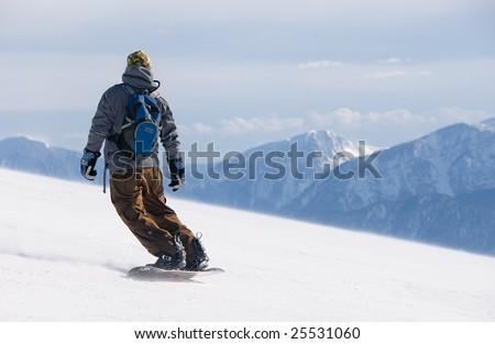 snowboarding man - stock photo