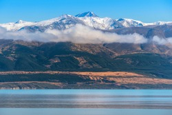 Snowcapped Mount Cook Glacier Mountain Peak in front of beautiful turquoise Lake Pukaki in Summer. South Island, Canterbury, New Zealand