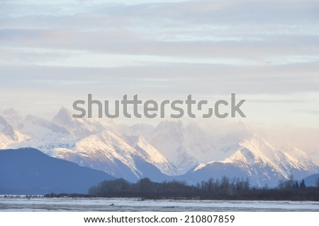Snowcovered Mountains in  Alaska. Chilkat State Park. Mud Bay. HAINES. Alaska. USA