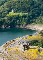 Snowdonia National Park, Wales, UK: Dolbadarn Castle in LLanberis, a 13th Century Fort with an old slate mine building in foreground