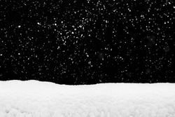 Snowdrift  and flying snow isolated over black, winter season