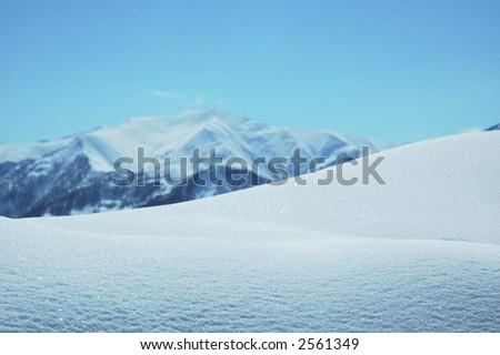 Snowdrift in bright winter day - Georgia, Gudauri