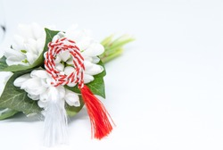 snowdrops and red and white string martisor on white with copy space east european first of march tradition celebration