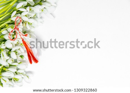 snowdrops flowers arranged on white background with copy space and first of march romanian bulgarian symbolic tradition  #1309322860