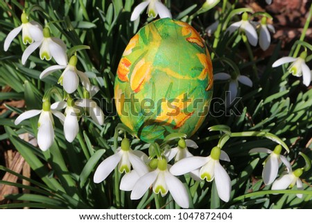 Snowdrops with decorative Easter egg #1047872404