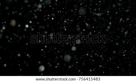 Snowfall Bokeh Lights on Black Background, Shot of Flying Snowflakes in the Air - Shutterstock ID 756415483
