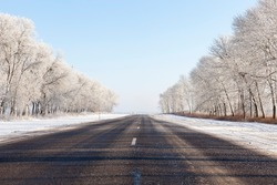 snowfall in the winter season and road asphalted roads, road in the winter season, snow that fell during the snowfall on the road