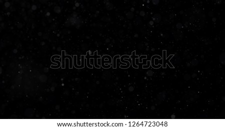 Snowfall on a black background #1264723048