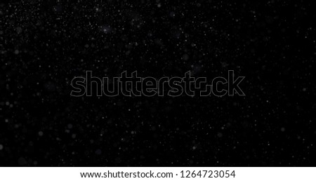 Snowfall on a black background #1264723054