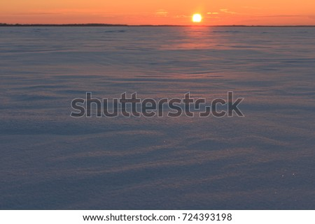 snowfield in the rays of the setting sun, Russia