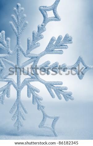 Snowflake big closeup. Bokeh a background. Toning is blue