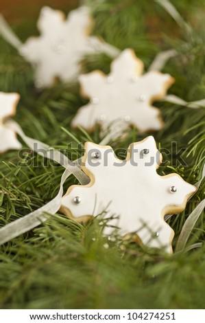 Snowflake cookies over an Christmas tree
