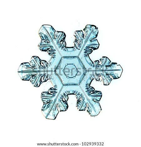 Snowflake on white background natural