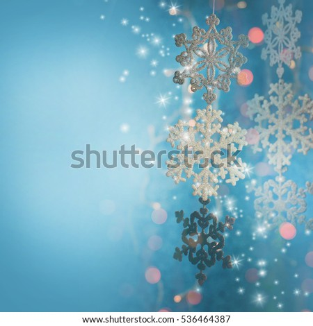 Snowflakes border on blue background with copy-space.Christmas snowflakes. #536464387